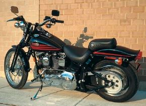 On the FXSTSB Bad Boy, only the front coil springs, headlight, exhaust pipes, handlebars, and various trim pieces carried chrome.
