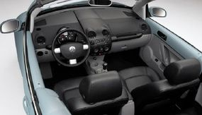 The open-air fun of the 2003 Volkswagen New Beetle convertible came at the expense of tighter rear-seat room and decreased cargo space.