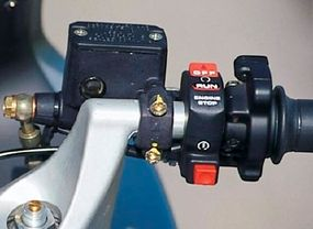"""The ST2's """"handlebars"""" aren't so much bars as artful castings bolted to the tops of the fork tubes."""