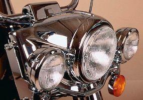 Heavily chromed, circular headlamps harken back to earlier Harley-Davidson models.