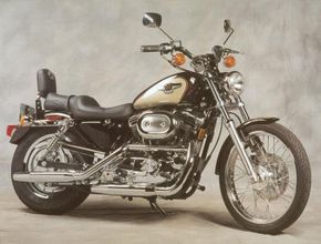 The 1998 Harley-Davidson XL-1200C Sportster Custom topped the three-model Sportster lineup. This one's dressed in anniversary trim. See more motorcycle pictures.