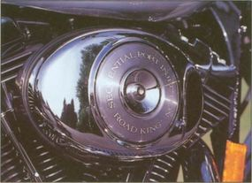 """The 1999 Harley-Davidson Road King featured several """"Classic"""" features, including distinct tank badges."""
