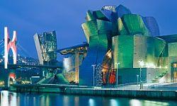 The Guggenheim Museum in Bilbao, Spain, illuminated at dusk