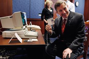 U.S. Senator Mark Kirk pulls a 3.5-inch floppy disc (remember those?) from a IBM PC Convertable. The historic machine was on display as part of the 25th anniversary of the Electronic Communications Privacy Act in 2011.