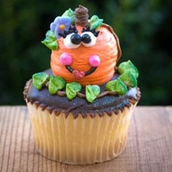 If the rich, spicy taste of pumpkin cupcakes doesn't appeal to you, how about a classic vanilla-chocolate cupcake garnished with a candy pumpkin?