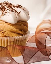 Coffee just seems to go with cups -- even cupcakes. This grown-up treat is frosted like a cup of cappuccino.