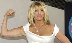Suzanne Somers shows off her famously toned physique as she's honored with a star on the Hollywood Walk of Fame.