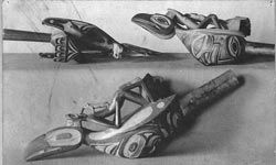 Shaman's rattles like these typically feature hand-carved handles.
