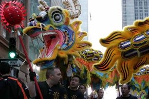 Members of a dragon team perform during the San Francisco Chinese New Year Festival.  This year, broaden your horizons by checking out a new cultural event.