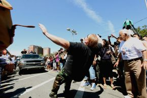 A participant pulls a truck loaded with men during the Olde Time Coney Island Strongman Spectacular.