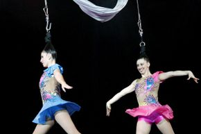 Two hair hanging performers.