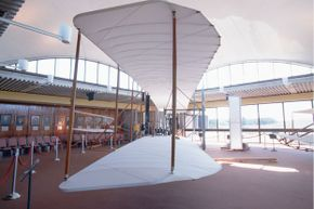 Full-size reproduction of the Wright brothers' 1902 glider at rest in the Wright Brothers National Memorial in Kitty Hawk, N.C.