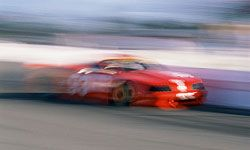 Race cars can reach speeds of 165 miles per hour.