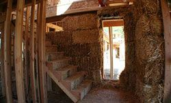 Steel rods or bamboo reinforcements help strengthen straw-bale houses.