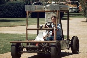 """Dr. Carlos Ordonez takes the """"CooLN2Car"""" for a spin across the campus of the University of North Texas in Denton, Texas, on Aug. 18, 1997. The car, a 1973 Volkswagen, runs on liquid nitrogen and has a top speed of 25 miles per hour."""
