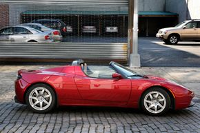 A Tesla Roadster electric car sits parked on a street in New York, on Feb. 19, 2009. Whatever the future holds for Tesla, the Roadster offers a glimpse of what's likely on the horizon for an auto industry that is increasingly going electric.