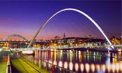 Millennium Bridge at dusk, viewed from Gateshead over the River Tyne to Newcastle upon Tyne
