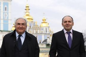 Party man Pinchuk (R) tends to business, not pleasure, as he and former International Monetary Fund head Dominique Strauss-Kahn (L) pose in the city of Kiev.
