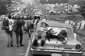 Aug. 27, 1969: Folks head out from the epic party that was the Woodstock Music Festival (except for those two sleeping on the car).