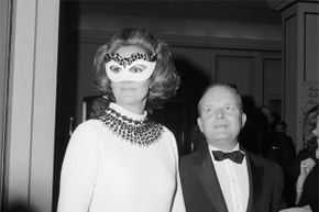 Author Truman Capote, host of the celebrated Black and White Ball, arrives at the Hotel Plaza holding hands with Katherine Graham, the guest of honor. Graham, of course, was the president of the Washington Post and Newsweek magazine.