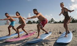 Before you get out into the surf to catch waves, you'll need to learn the basics -- on land.