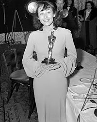 Luise Rainer wears a nightgown to claim her second Oscar.