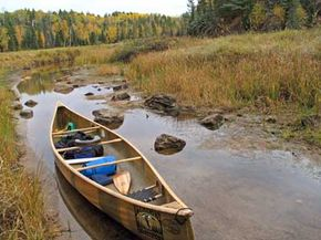 A canoe rests in shallow water at Mudro Lake in the Boundary Waters Canoe Area near Ely, Minn.