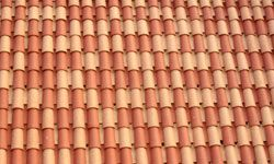 Traditional terra cotta tiles keep buildings cool through their shape as much as their composition.
