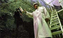 A South Korean nuclear scientist tests a partly dismantled experimental reactor for radiation at Korea Atomic Energy Research Institute, on Sept. 10, 2004, in Seoul.