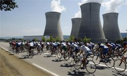 It's business as usual at this French nuclear facility as Tour de France riders whiz past on July 12, 2003.
