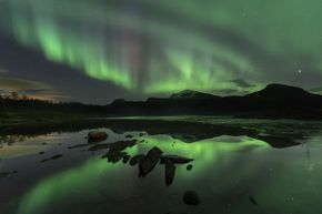 The green glow of the Northern Lights looks almost supernatural.