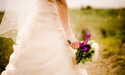 Shady, natural light, rather than direct sunlight, is most flattering for bridal portrait photos.