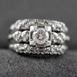A modern trend is to wear two diamond bands sandwiched around your engagement ring.