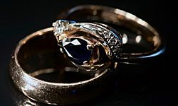 These vintage his and her gold wedding rings tastefully incorporate a pop of color with a rich sapphire.