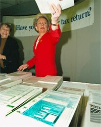 Internal Revenue Commissioner Margaret Milner Richardson hands out tax forms in Washington, D.C., in April 1995. The IRS really does want you to file -- something.