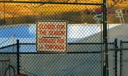 Locking a poolside fence may help prevent kids from going into a pool area without permission.