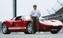 Sir Jackie Stewart poses with the new Ford GT before the Formula One United States Grand Prix on Sept. 28, 2003 in Indianapolis, Ill.
