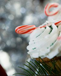 A mini candy cane adds a touch of holiday flair to a cupcake.