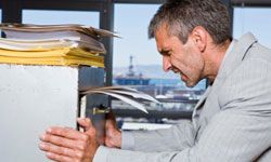 Don't force the file cabinet drawer shut -- it could tip over on you.