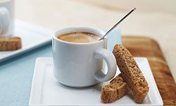 A chocolate spoon adds a sweet touch to morning coffee.