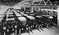 A view inside the Ford Motor Company factory with rows of new Model T motor cars.