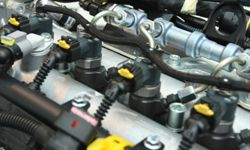 Why did fuel injection replace the carburetor?