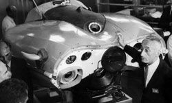 Jaques Cousteau shows off a one-man submarine prototype, the sea flea.