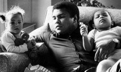 Muhammad Ali plays with his daughters, Hanna and Laila.