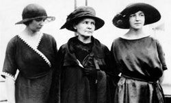 Physicist Marie Curie, flanked by her daughters Ève and Irène.