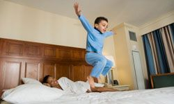 For a kid, the hotel room is a playground.
