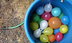 A water balloon toss can include the entire family.