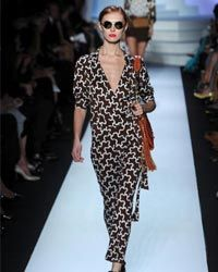 You don't have to be a runway model to wear the wrap dress. Its shape and construction is very figure-friendly.