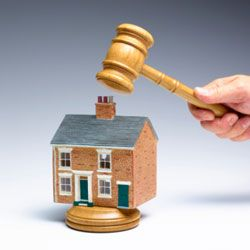 A home that isn't successfully sold at auction may become REO (real estate owned).