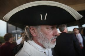 William Temple, dressed as Button Gwinnett, one of the signers of the Declaration of Independence, waits in line to enter Stephens Auditorium at Iowa State University, for the Republican Party debate Aug. 11, 2011, in Ames, Iowa.